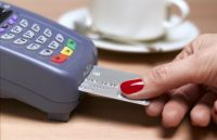 credit card being inserted by womeen
