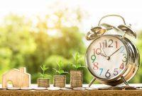 analog clock with money increasing