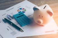 pink piggy bank on financial documents